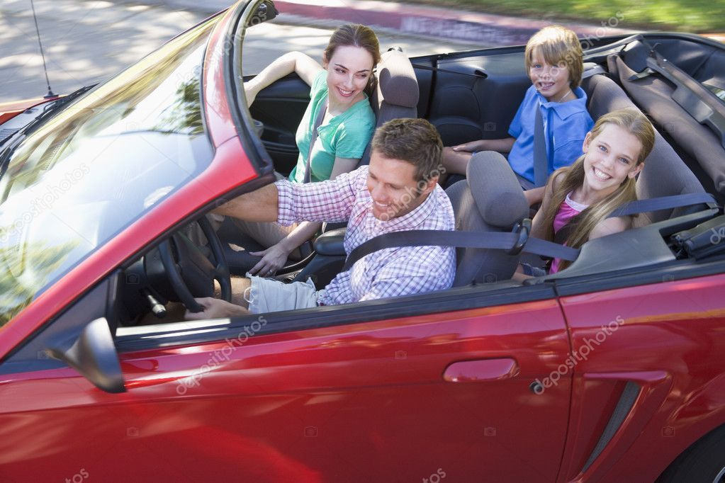 Family in convertible car smiling Stock Photo ,