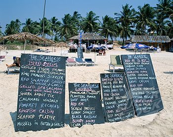 Chalkboard menus of a restaurant on the beach, Colva Beach, Goa, India