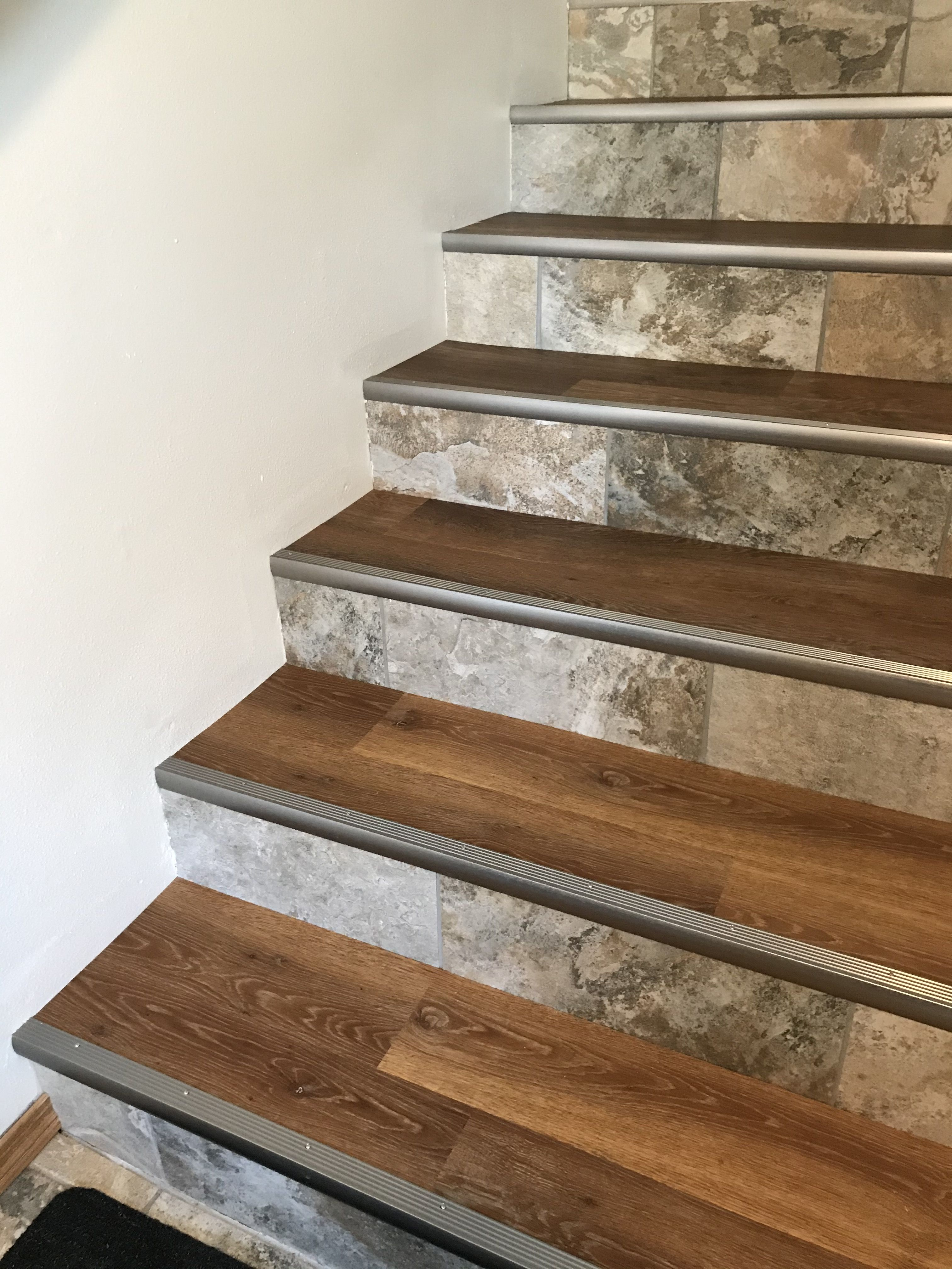 My Stairs Finally Finished Luxury Vinyl Plank On The Treads Which Matches The Upstairs Rooms Porcelain Tile On In 2020 Tile Stair Nosing Rustic Stairs Stair Nosing
