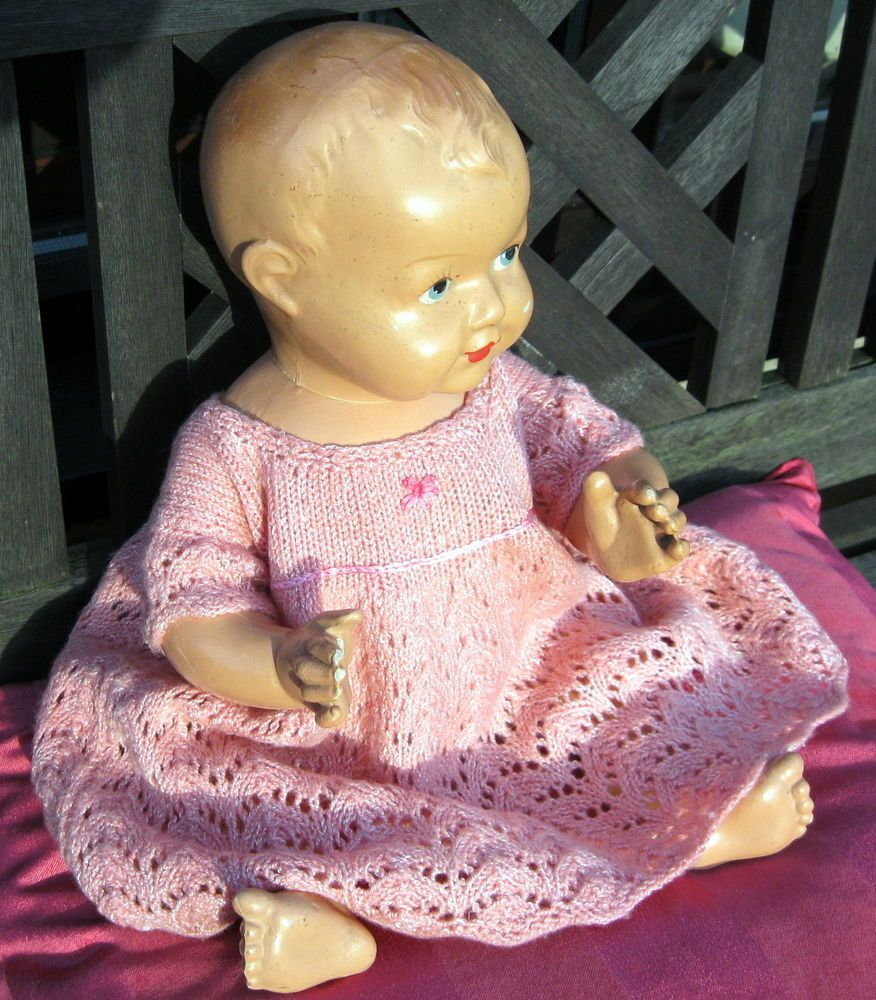 Vintage baby doll ,Stamped on back .18 inches ,very realistic.Pretty face ,Solid
