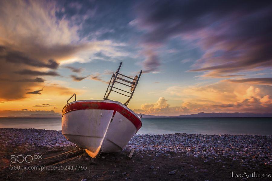Popular on 500px : colorful sunset by iliasanthitsas