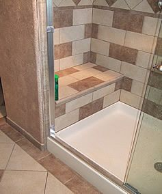 Showers with a seat height window in your shower area for Bathroom remodelers in my area