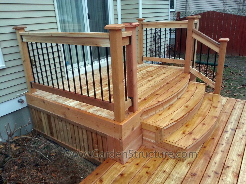 Small Patio Deck Leading Out Of The House, With Stairs Leading To A Large  Low Patio Deck