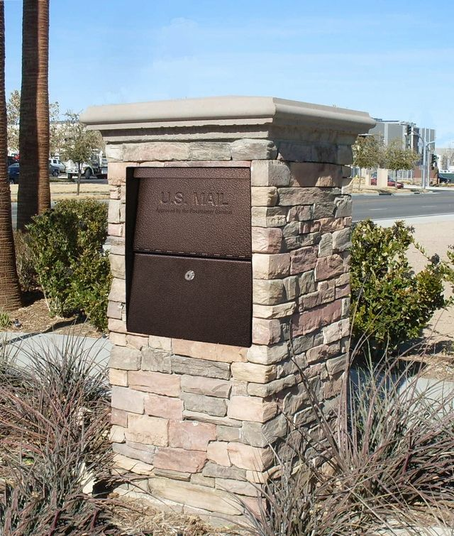 High security locking mailbox in stone column home for Rock pillars on house