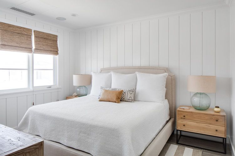 Cottage Bedroom With Vertical Shiplap Wall Trim Displays A Tan Upholstered Bed White Bedding