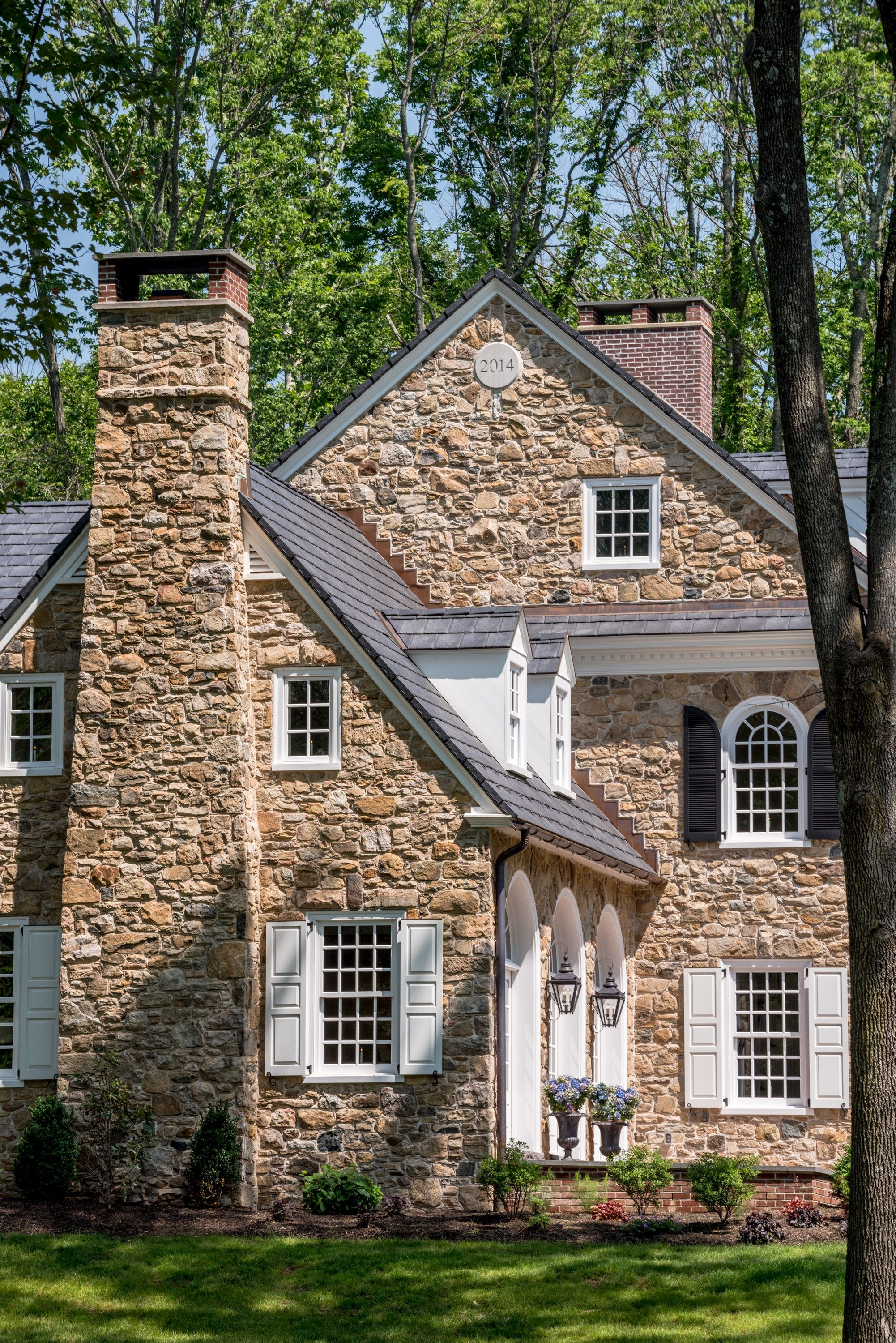 Colonial Revival Stone Farmhouse With Arch Top Window Details In Horsham PA