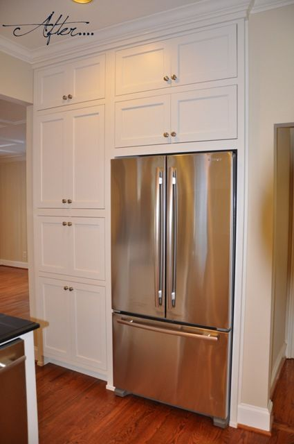 Pantry Beside Fridge And Cabinets Above