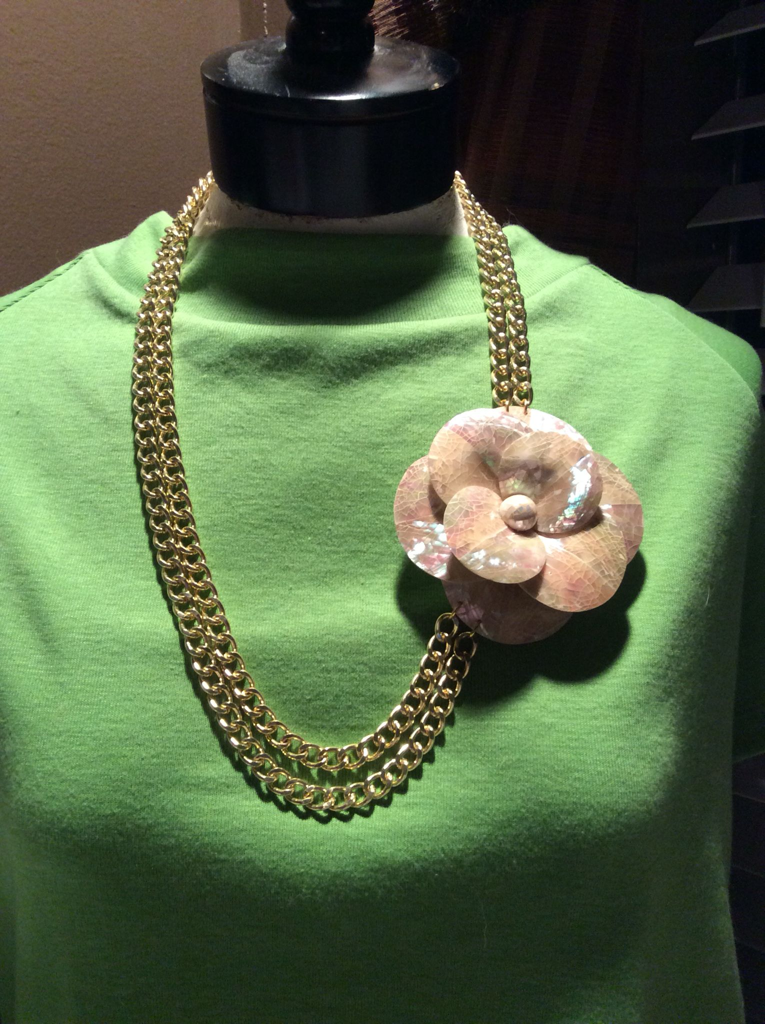 Mother of pearl flower with large gold chains, necklace.