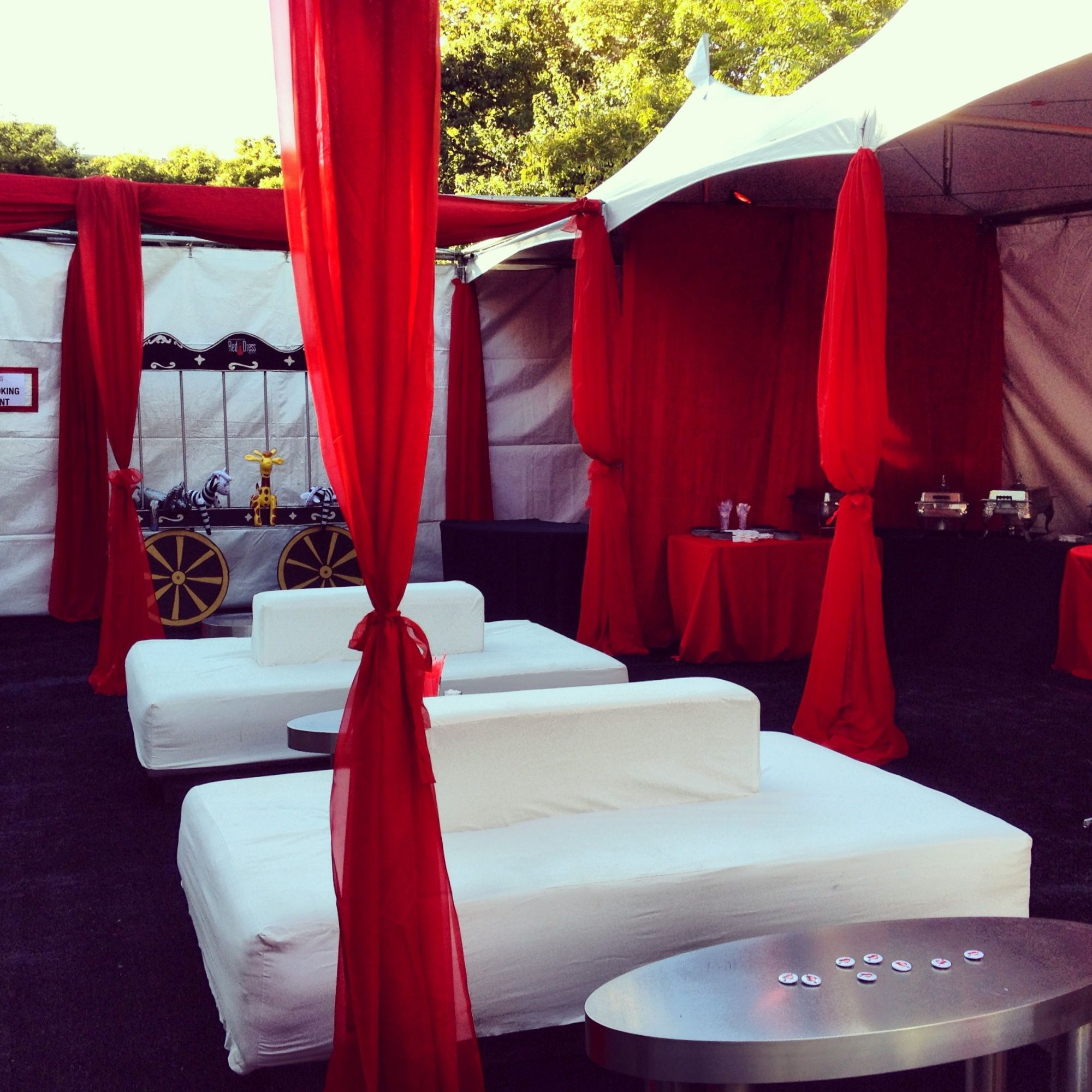 festival tents situated in a u shape with various decor and lounge furniture - U Shape Canopy Decorating