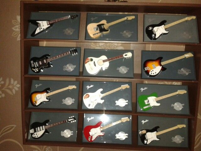 My own miniature  collection of famous guitarists, from elvis to john lennon, hendrix, bruce springsteen, AC-DC, keith richards, ect,,,