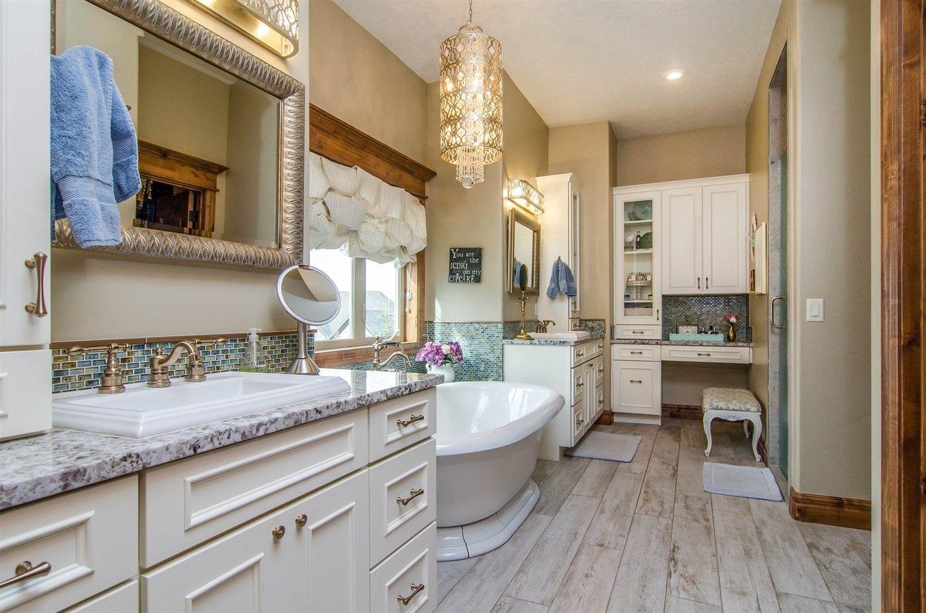 Beautiful bathroom with soaking tub and separate vanities ...