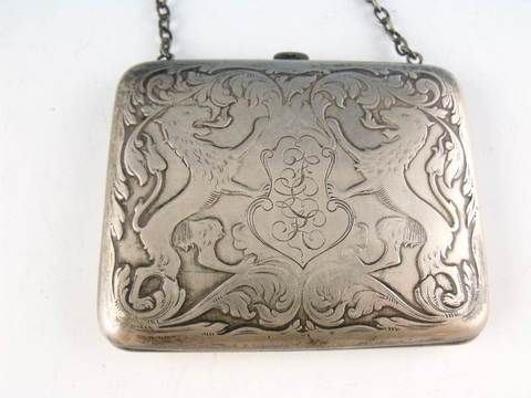 """An antique sterling silver """" card holder"""" on a chain with a silver latch most likely used as a dance card carrier for formal social affairs."""