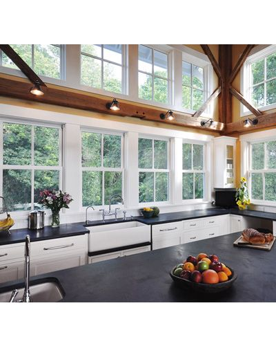 Classic White Marvin Ultimate Double Hung Windows Provide Light To This Airy Kitch Kitchens Without Upper Cabinets Upper Cabinets Kitchen Without Wall Cabinets