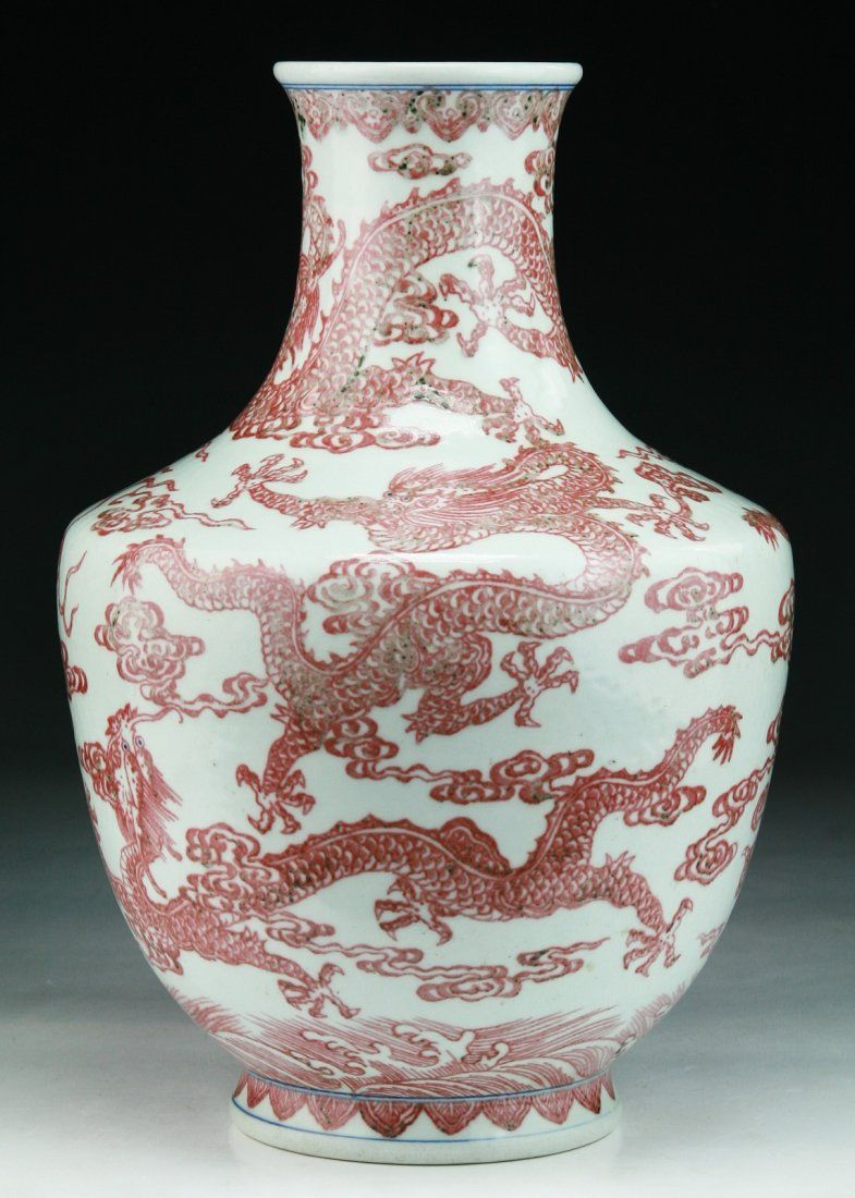 A Chinese Antique Iron Red Porcelain Vase: the six character 'QIANLONG' mark in cobalt blue on the base and of the period; Size: H: 11-1/2""