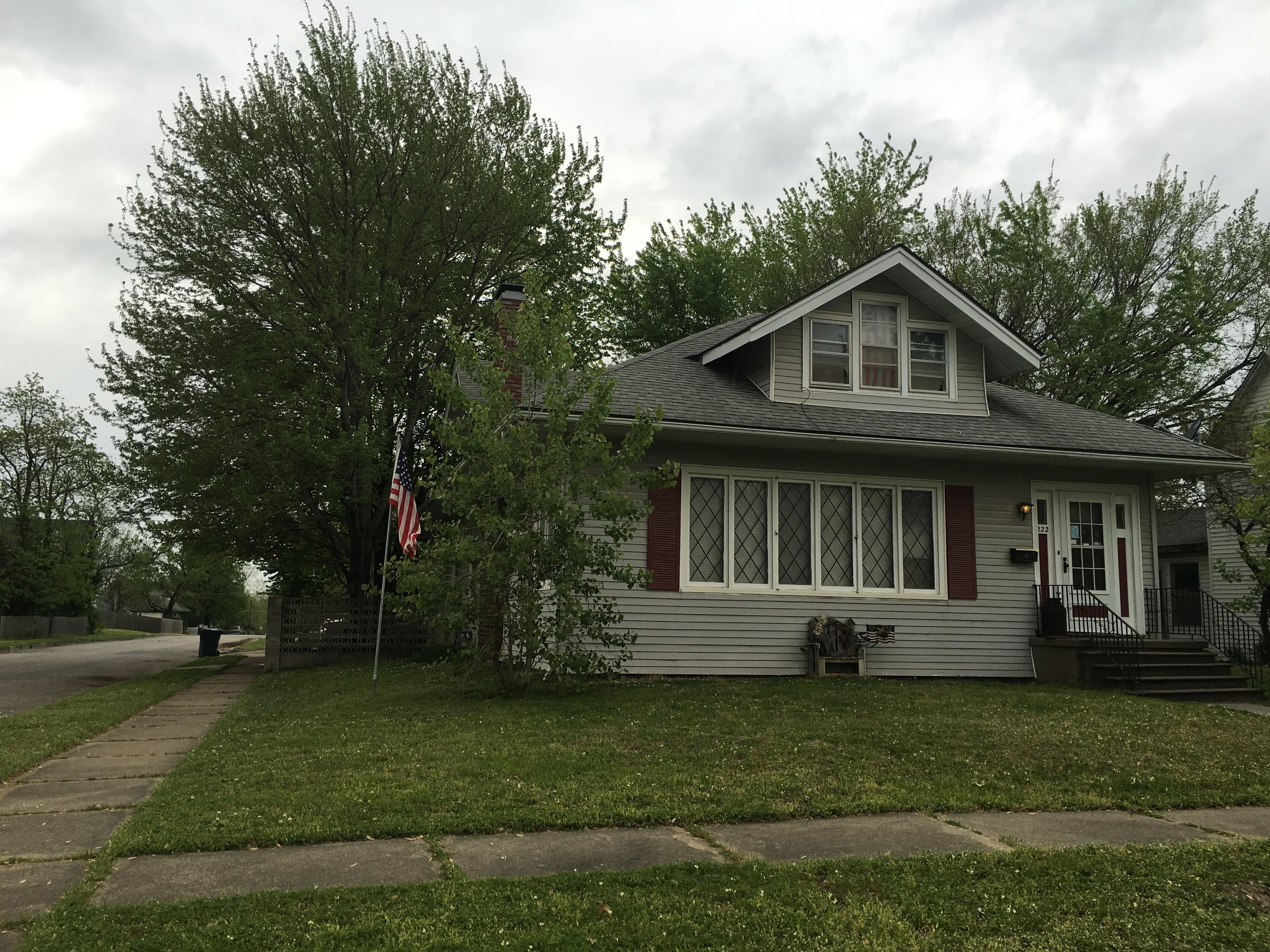 Beautiful 1 1/2 story older conventional home on corner lot. This spacious home features an eat-in kitchen and formal dining room. There are hardwoods through most of the home, large bedrooms and a closed-in front porch. Over 2900 square feet!  Only $114,900  Call Rhonda 417-622-2850