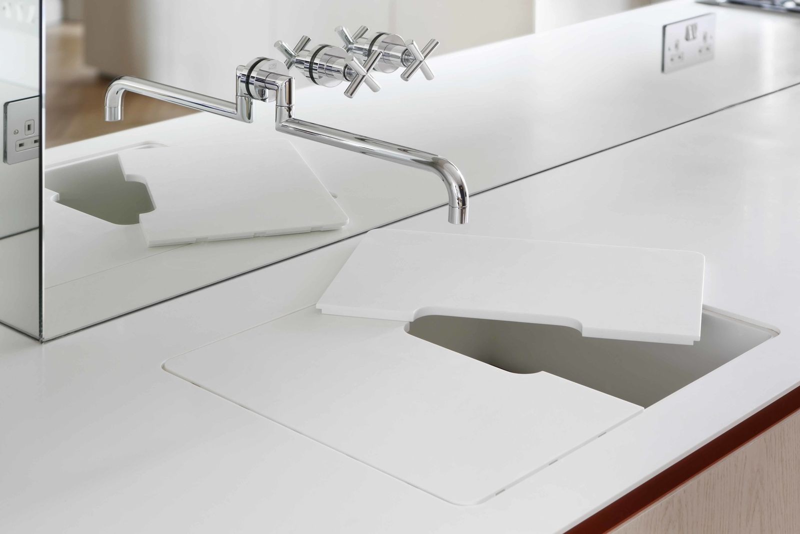A Dornbracht Tap Sits Above A Custom Built Glacier White Corian Countertop  And Sink.