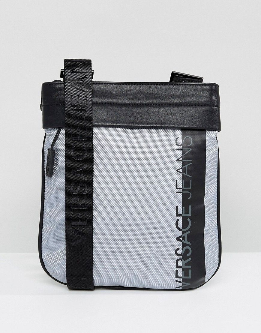 VERSACE JEANS FLIGHT BAG IN GRAY WITH LARGE LOGO - GRAY.  versacejeans   21a354418bfd1