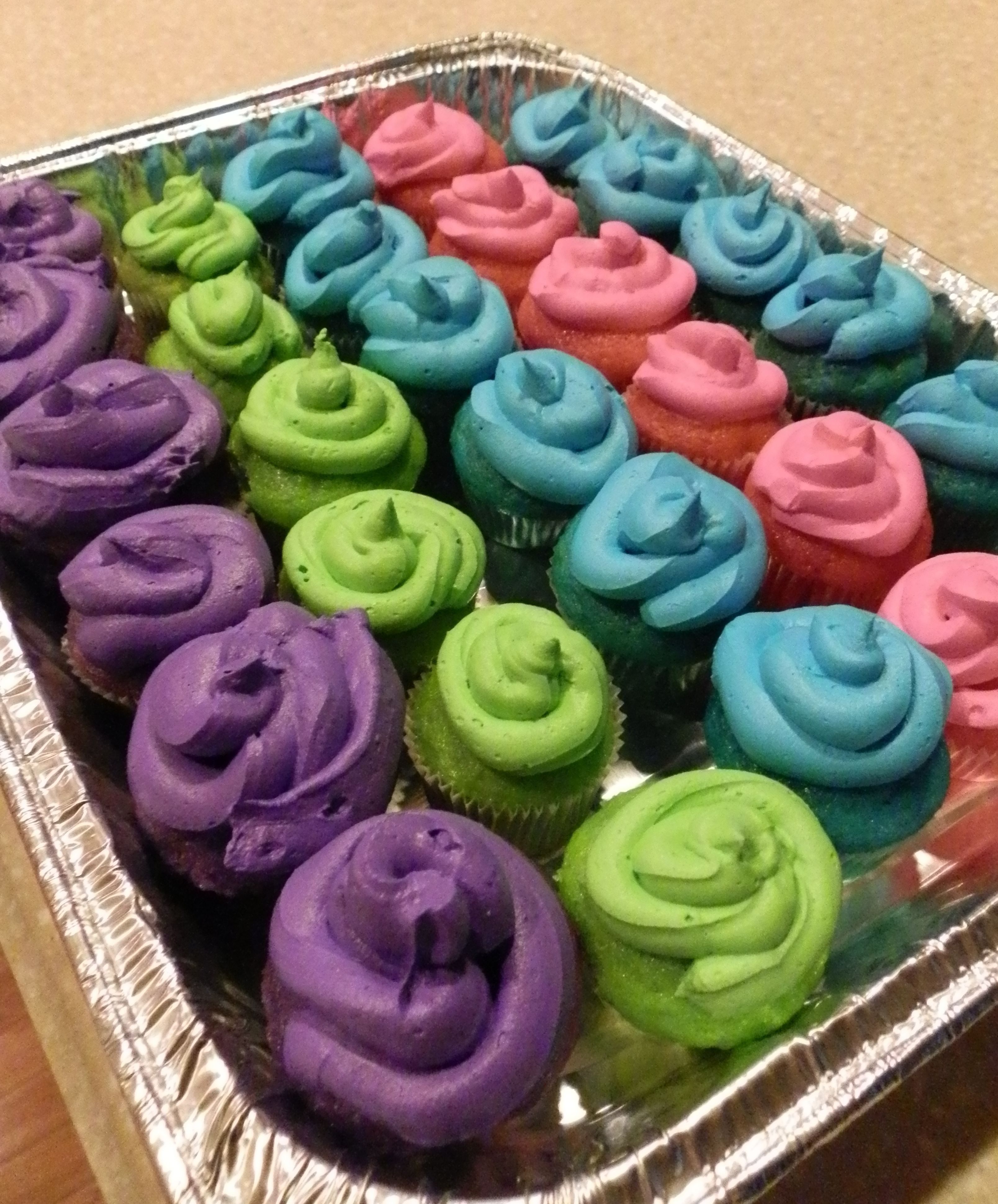 Bright neon colored cupcakes and icing. I love Duff\'s color gels ...