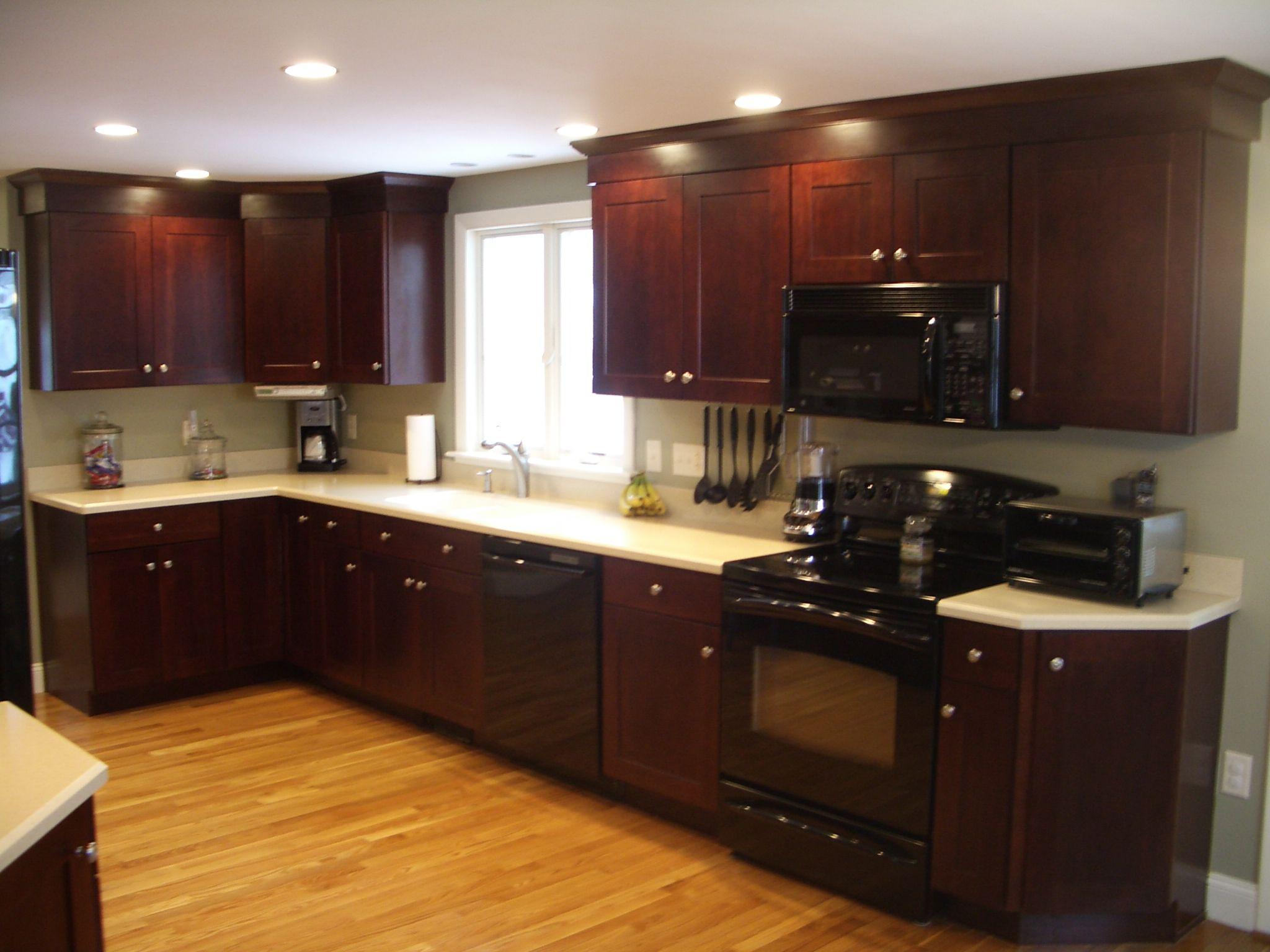 Exceptional Shaker Style Kitchen, Kitchen Cabinet, Corian Countertop, White  Countertops, Black Appliances,