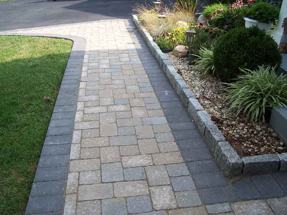 Stone walkway stone work by professional stone work for Paving stone garden designs