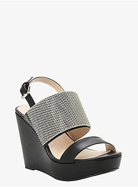 <p>It's time to join the chain gang! This swank black faux leather sandal…