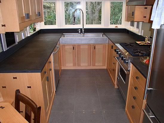 Kithens with mediun cabnets and dark floors dark tile for Black floor tiles for kitchen