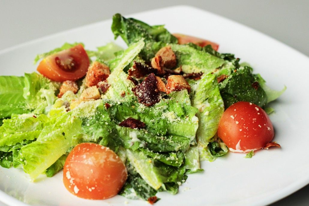 Caesar salad with fresh Romaine, croutons, turkey bacon bits, cherry tomatoes and grated Parmesan cheese.