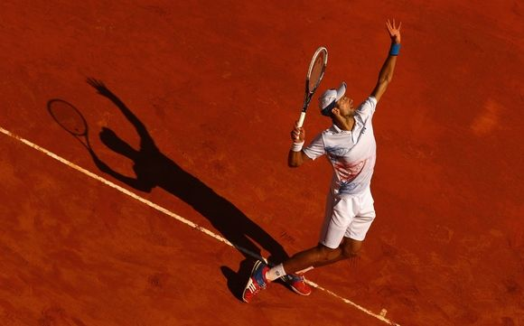 Novak Djokovic of Serbia serves against Tomas Berdych of Czech Republic in their semi-final during day seven of the ATP Monte Carlo Masters, at Monte-Carlo Sporting Club on April 21, 2012 in Monte-Carlo, Monaco. (Photo by Clive Brunskill/Getty Images)