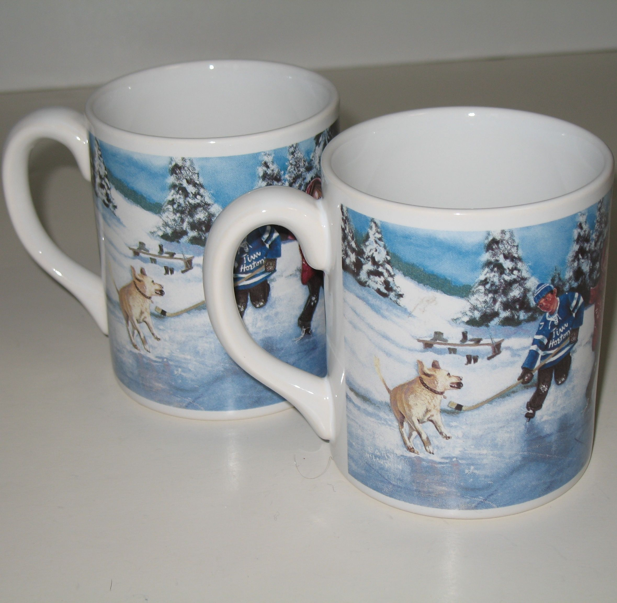Feeling WINTERY? Here's a pair of Tim Hortons coffee mugs