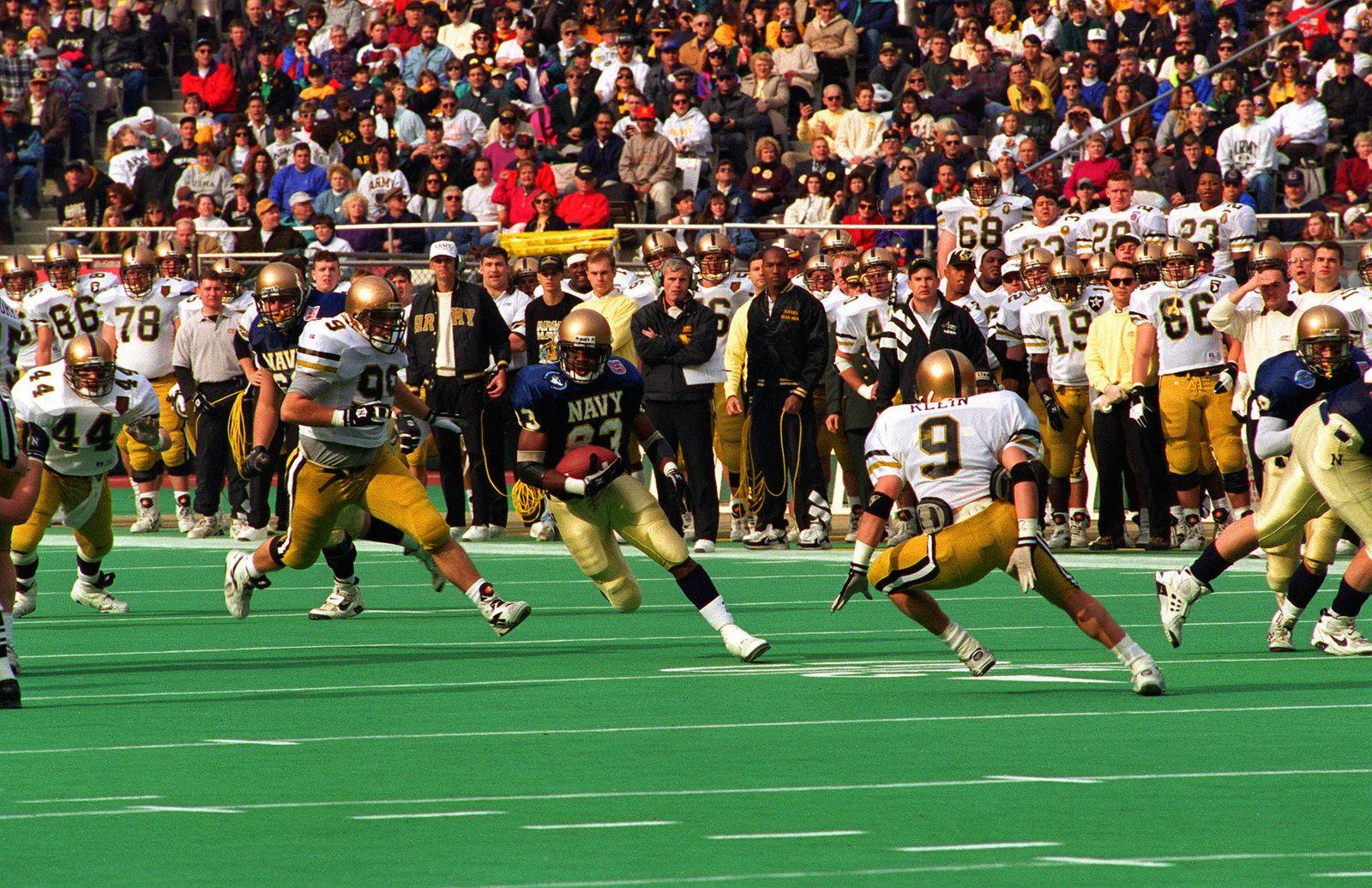 A U S Naval Academy Football Player Advances The Ball Forward During The Annual Army Navy Football Gam Army Navy Football Naval Academy Football Navy Football