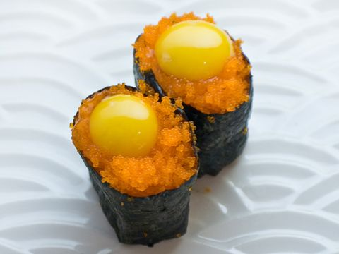 Quail Egg Tobiko    sushi with flying fish eggs and qual egg