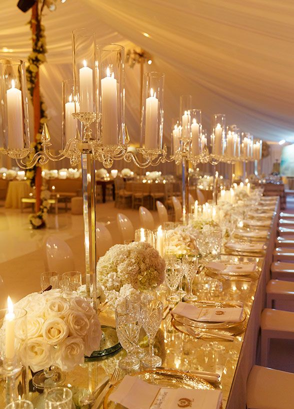 Banquet tables covered in white blooms, metallic accents and ...