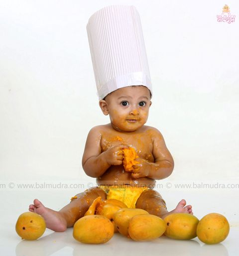 Baby boy in Balmudra Studio - Enjoying mangoes # Photographer PhotographerinPune # ChildModelling # KidsPhotographyinPune # Pune # PuneKids # NewbornPhotoShootsinPune