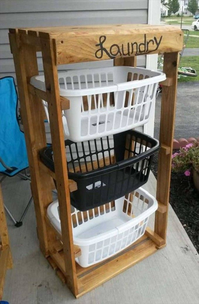 turn pallets into a laundry basket holder these are the