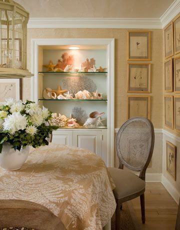 Dinning Room with bird cage turned light fixture, framed botanical walls, honey colored grasscloth on the walls