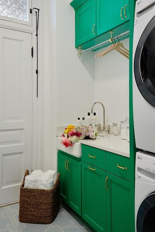 emerald green laundry room cabinets are accented with antique brass pulls and white quartz on kitchen ideas emerald green id=58552