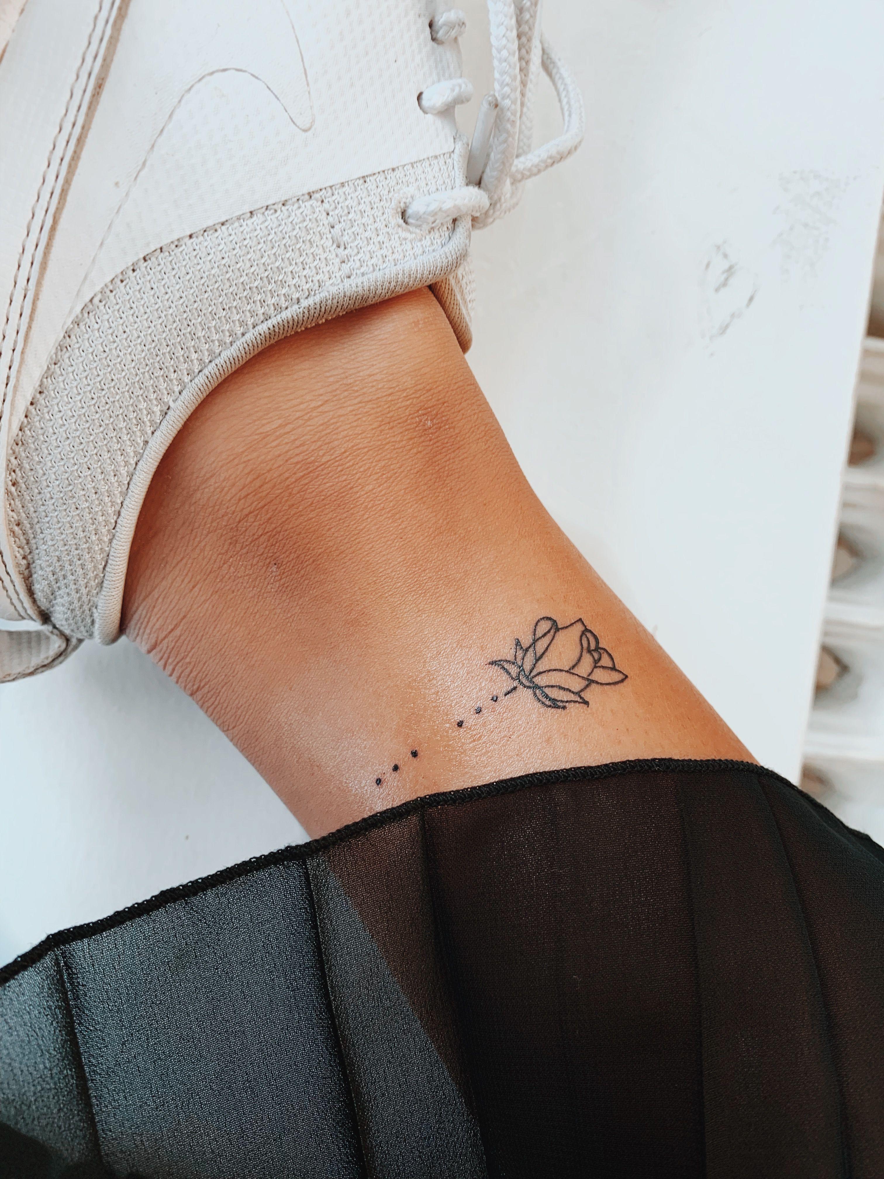 Photo of Rose tattoo