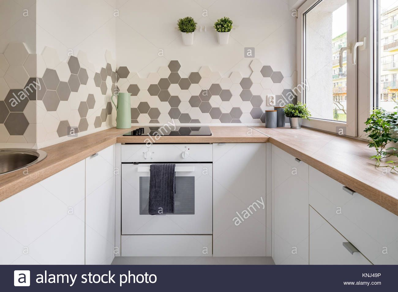 Kitchen In Scandinavian Style With White Cabinets Wooden Countertop And Hex Kitchen Backsplash Tile Designs Unique Kitchen Backsplash Kitchen Tiles Backsplash