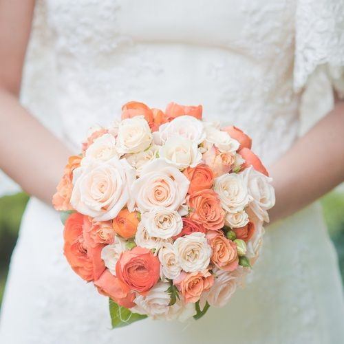 Round Bridal Bouquet Comprised Of Coral Spray Roses Ranunculus Pastel Peach Cream
