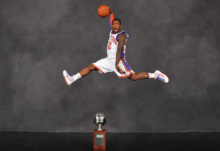 Husky Basketball Alum Nate Robinson with his 3rd NBA Dunk Contest trophy!