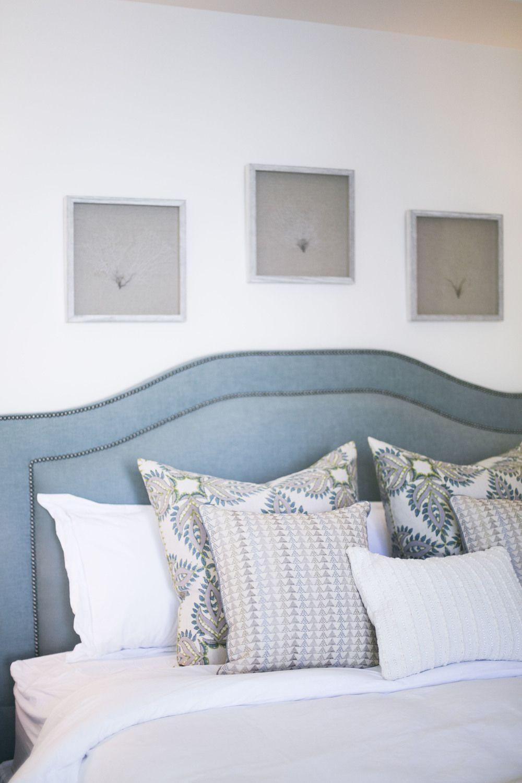 Headboard framed sea fans and block print pillows hayley bridges