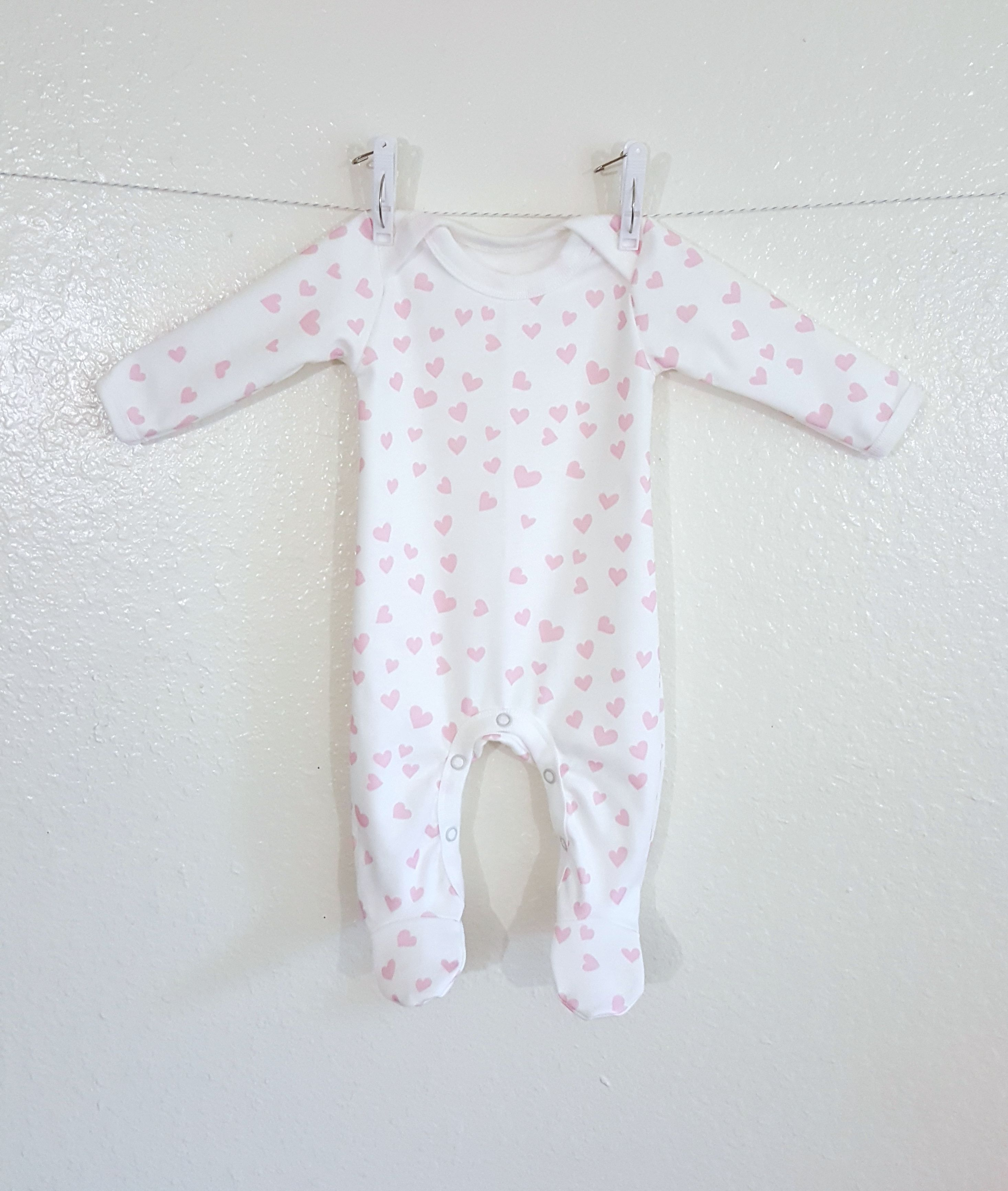 Organic baby footie in mini pink hearts 47f851706