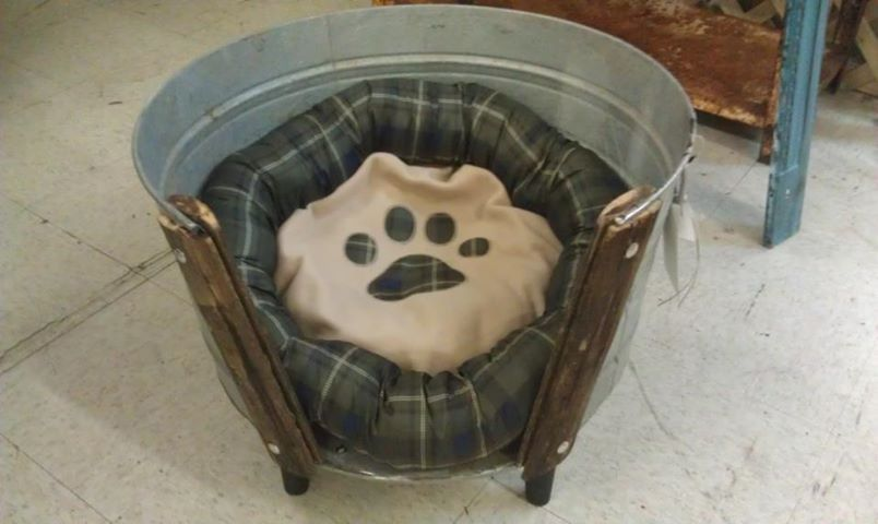 Adorable dog bed made out of a vintage wash tub.