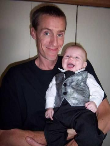 Good lookin' Papa with his dressed to impress little man.
