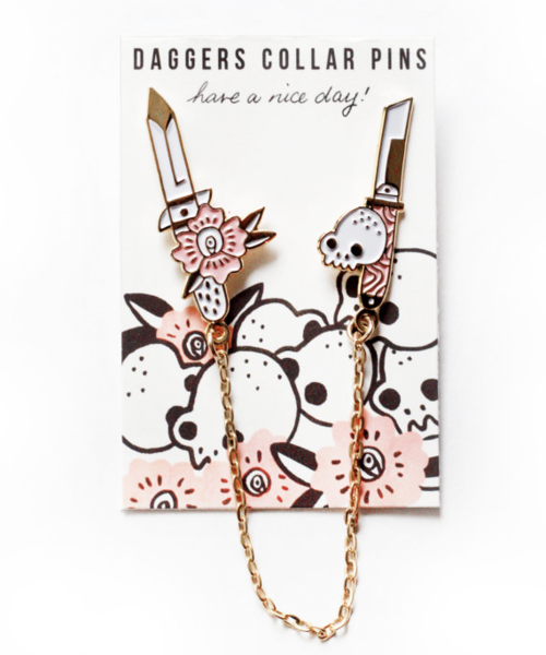Daggers Collars Soft Enamel Pin Two 1.25 inch pin chained together Each pin is presented on an illustrated backing Gold plated Black back fixing