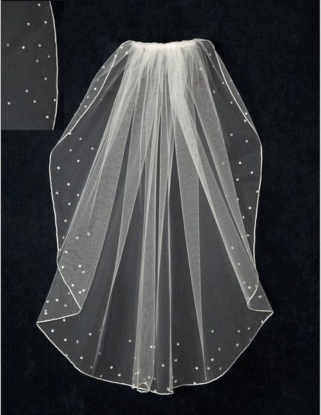 This wedding veil has an embroidered edge and a scatter of rhinestones and crystal beads.Itis25 inches long by54 inches wide, on a four inch metal comb. Bec