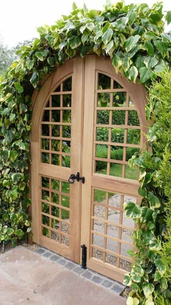 Wooden Garden Gates Covered In Climbers In 2020 Garden Gate Design Wooden Garden Gate Fence Design