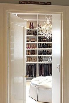 Seating and chandelier in closet