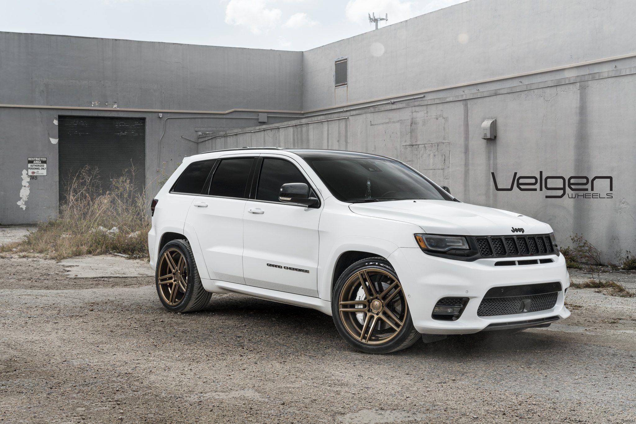 Modern Looking White Jeep Grand Cherokee Rocks A Set Of