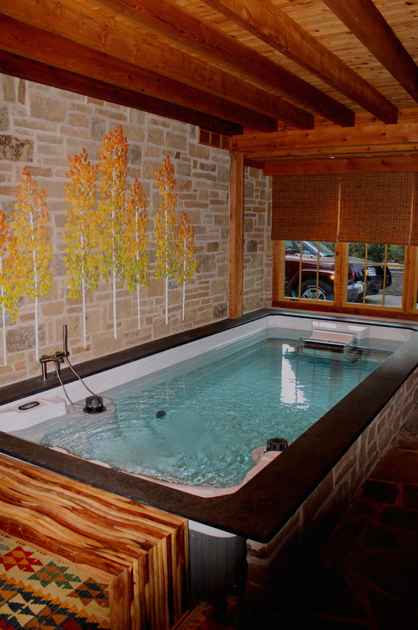A beautiful indoor swim spa installed in a converted for Swimming pool conversion